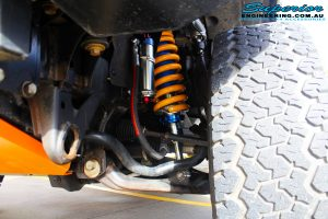 Right close up inside guard view of the fitted Superior Adjustable Remote Reservoir Strut with King Coil Springs & Superior Upper Control Arm