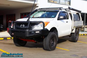 Left front side view of a White Mazda BT50 Freestyle Cab after fitment of a range of quality parts and accessories from Superior Engineering
