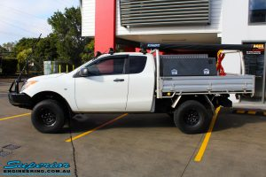 Side left view of a White Mazda BT50 Freestyle Cab after fitment of a range of quality parts and accessories from Superior Engineering