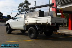 Rear left view of a White Mazda BT50 Freestyle Cab after fitment of a range of quality parts and accessories from Superior Engineering