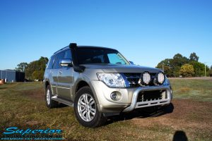 Right front side view of a Mitsubishi Exceed Pajero Wagon in Gold before fitment of a Ironman 4x4 Deluxe Black Commercial Bull Bar