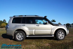 Right side view of a Mitsubishi Exceed Pajero Wagon in Gold before fitment of a Ironman 4x4 Deluxe Black Commercial Bull Bar