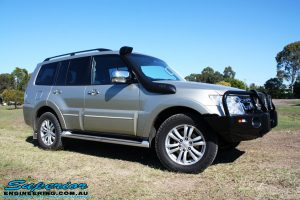 Right front side view of a Mitsubishi Exceed Pajero Wagon in Gold after fitment of a Ironman 4x4 Deluxe Black Commercial Bull Bar