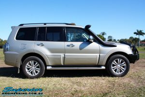 Right side view of a Mitsubishi Exceed Pajero Wagon in Gold after fitment of a Ironman 4x4 Deluxe Black Commercial Bull Bar