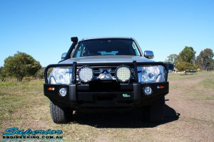 Front view of the bonnet on a Mitsubishi Exceed Pajero Wagon in Gold after fitment of a Ironman 4x4 Deluxe Black Commercial Bull Bar