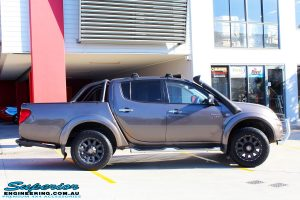 """Right side view of a Mitsubishi MN Triton in Bronze before fitment of a Superior Nitro Gas 2"""" Inch Lift Kit + 2"""" Inch Body Lift"""