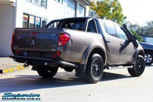 "Rear right view of a Mitsubishi MN Triton in Bronze before fitment of a Superior Nitro Gas 2"" Inch Lift Kit + 2"" Inch Body Lift"