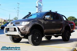 """Left front side view of a Mitsubishi MN Triton in Bronze after fitment of a Superior Nitro Gas 2"""" Inch Lift Kit + 2"""" Inch Body Lift"""