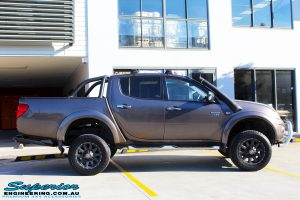 """Right side view of a Mitsubishi MN Triton in Bronze after fitment of a Superior Nitro Gas 2"""" Inch Lift Kit + 2"""" Inch Body Lift"""