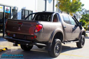 """Rear right view of a Mitsubishi MN Triton in Bronze after fitment of a Superior Nitro Gas 2"""" Inch Lift Kit + 2"""" Inch Body Lift"""