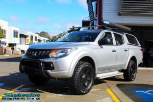 Left front side view of a Mitsubishi MQ Triton in Silver before fitment of a Superior Nitro Gas 30mm Lift Kit