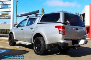 Rear left view of a Mitsubishi MQ Triton in Silver before fitment of a Superior Nitro Gas 30mm Lift Kit