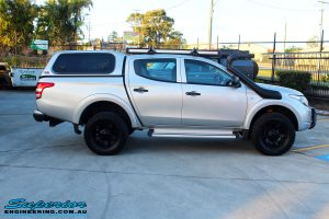 Left side view of a Mitsubishi MQ Triton in Silver after fitment of a Superior Nitro Gas 30mm Lift Kit