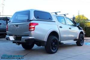 Rear left view of a Mitsubishi MQ Triton in Silver after fitment of a Superior Nitro Gas 30mm Lift Kit