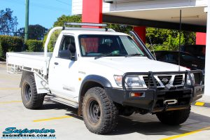 """Front right side view of a White Nissan GU Patrol Ute before fitting the Superior 4"""" Inch Remote Reservoir Hyperflex Kit with Fox Shocks"""