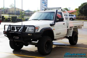 "Front left side view of a White Nissan GU Patrol Ute after fitment of the Superior 4"" Inch Remote Reservoir Hyperflex Kit with Fox Shocks"