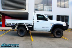 """Right side view of a White Nissan GU Patrol Ute after fitting the Superior 4"""" Inch Remote Reservoir Hyperflex Kit with Fox Shocks"""