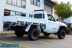 """Rear right side view of a White Nissan GU Patrol Ute after fitting the Superior 4"""" Inch Remote Reservoir Hyperflex Kit with Fox Shocks"""
