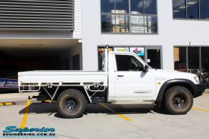 "Right side view of a White Nissan GU Patrol Ute before fitting the Superior 4"" Inch Remote Reservoir Hyperflex Kit with Fox Shocks"