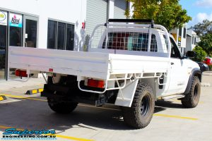 """Rear right side view of a White Nissan GU Patrol Ute before fitting the Superior 4"""" Inch Remote Reservoir Hyperflex Kit with Fox Shocks"""