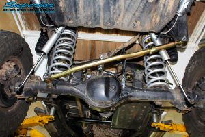 Rear view of a Superior Panhard Rod, Coil Springs, Bump Stop Extensions & Fox 2.0 Performance Shocks