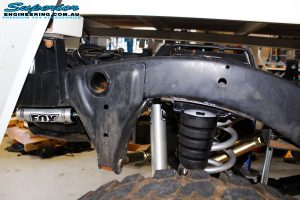 Rear left inside shot of the fitted Fox 2.0 Performance Series Shocks with Superior Bump Stop Extensions and Coil Springs