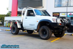 "Front right side view of a White Nissan GU Patrol Ute after fitment of the Superior 4"" Inch Remote Reservoir Hyperflex Kit with Fox Shocks"