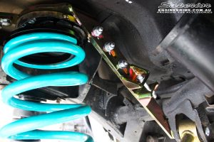 Rear left close up shot of the fitted Superior Coil Tower Brace & Dobinson Coil Spring