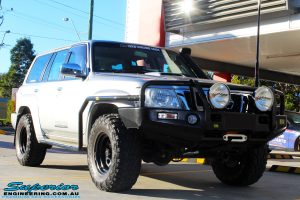Right front side view of a Grey Nissan Patrol GU Wagon before fitting a Superior Remote Reservoir Hybrid Dropped Radius 4 Inch Lift Kit with Hyperflex Radius Arms, Lower Control Arms, Tie Rod, Heim Draglink, Superior Front & Rear Sway Bar Kits, Rear Bumpstop and Superior Shock Tower Lift Kit