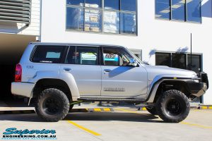 Right side view of a Grey Nissan Patrol GU Wagon after fitting a Superior Remote Reservoir Hybrid Dropped Radius 4 Inch Lift Kit with Hyperflex Radius Arms, Lower Control Arms, Tie Rod, Heim Draglink, Superior Front & Rear Sway Bar Kits, Rear Bumpstop and Superior Shock Tower Lift Kit