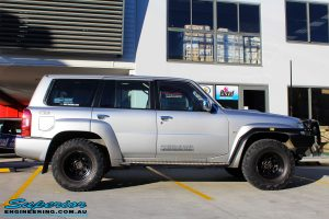 Right side view of a Grey Nissan Patrol GU Wagon before fitting a Superior Remote Reservoir Hybrid Dropped Radius 4 Inch Lift Kit with Hyperflex Radius Arms, Lower Control Arms, Tie Rod, Heim Draglink, Superior Front & Rear Sway Bar Kits, Rear Bumpstop and Superior Shock Tower Lift Kit