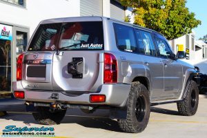 Rear right side view of a Grey Nissan Patrol GU Wagon before fitting a Superior Remote Reservoir Hybrid Dropped Radius 4 Inch Lift Kit with Hyperflex Radius Arms, Lower Control Arms, Tie Rod, Heim Draglink, Superior Front & Rear Sway Bar Kits, Rear Bumpstop and Superior Shock Tower Lift Kit