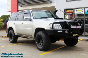 """Right front side view of a Silver Nissan Patrol GU Wagon before fitting the Superior Remote Reservoir 4"""" Inch Hybrid Superflex Lift Kit with Fox Shocks"""
