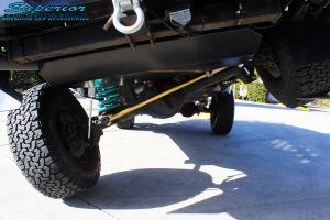 """Front mid underbody view of a flexed Silver Nissan Patrol GU Wagon after fitting the Superior Remote Reservoir 4"""" Inch Hybrid Superflex Lift Kit with Fox Shocks"""