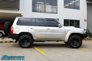 """Right side view of a Silver Nissan Patrol GU Wagon before fitting the Superior Remote Reservoir 4"""" Inch Hybrid Superflex Lift Kit with Fox Shocks"""