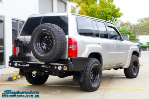 "Rear right side view of a Silver Nissan Patrol GU Wagon before fitting the Superior Remote Reservoir 4"" Inch Hybrid Superflex Lift Kit with Fox Shocks"