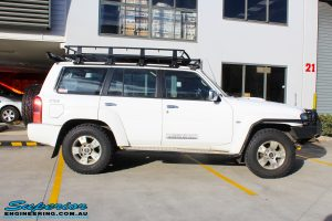 """Right side view of a White Nissan GU Patrol Wagon before fitment of a Superior Nitro Gas 2"""" Inch Lift Kit"""