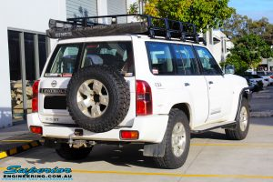 """Rear right view of a White Nissan GU Patrol Wagon before fitment of a Superior Nitro Gas 2"""" Inch Lift Kit"""