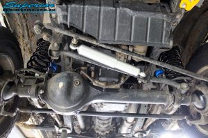 """Front mid underbody view of the fitted Superior Nitro Gas 2"""" Shocks, Steering Damper + Coil Spring"""