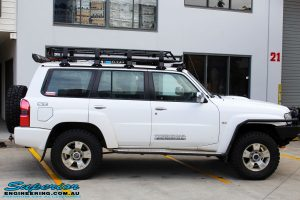 """Right side view of a White Nissan GU Patrol Wagon after fitment of a Superior Nitro Gas 2"""" Inch Lift Kit"""
