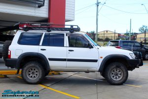 Right side view of a Nissan GU Patrol Wagon in White On The Hoist @ Superior Engineering Deception Bay Showroom