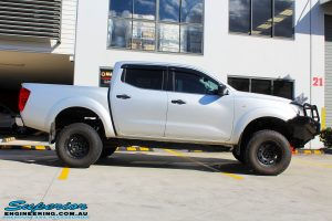 """Right side view of a Grey Nissan NP300 Navara Ute after fitment of a Superior Remote Reservoir 2"""" Inch Lift Kit + Ironman 4x4 Deluxe Black Bull Bar & Superior 2"""" Inch Body Lift"""