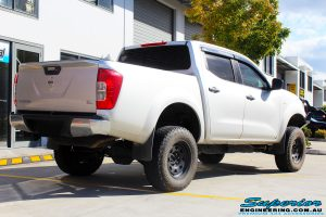 """Rear right view of a Grey Nissan NP300 Navara Ute after fitment of a Superior Remote Reservoir 2"""" Inch Lift Kit + Ironman 4x4 Deluxe Black Bull Bar & Superior 2"""" Inch Body Lift"""