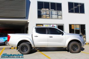 """Right side view of a Grey Nissan NP300 Navara Ute before fitment of a Superior Remote Reservoir 2"""" Inch Lift Kit + Ironman 4x4 Deluxe Black Bull Bar & Superior 2"""" Inch Body Lift"""