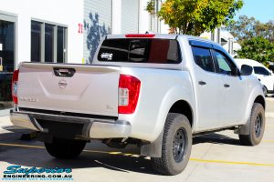 "Rear right view of a Grey Nissan NP300 Navara Ute before fitment of a Superior Remote Reservoir 2"" Inch Lift Kit + Ironman 4x4 Deluxe Black Bull Bar & Superior 2"" Inch Body Lift"