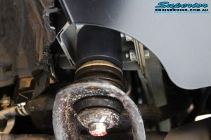 """Rear close up shot of a fitted Superior 2"""" Inch Body Lift block"""