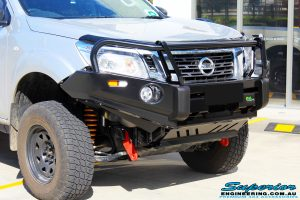 """Right front close up shot of the fitted Ironman 4x4 Deluxe Black Bull Bar with the Superior 2"""" Inch Remote Reservoir Kit & Body Lift"""