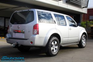 Rear right side view of a Silver Nissan R51 Pathfinder Wagon before fitment of a 40mm Lift Kit & Safari Snorkel