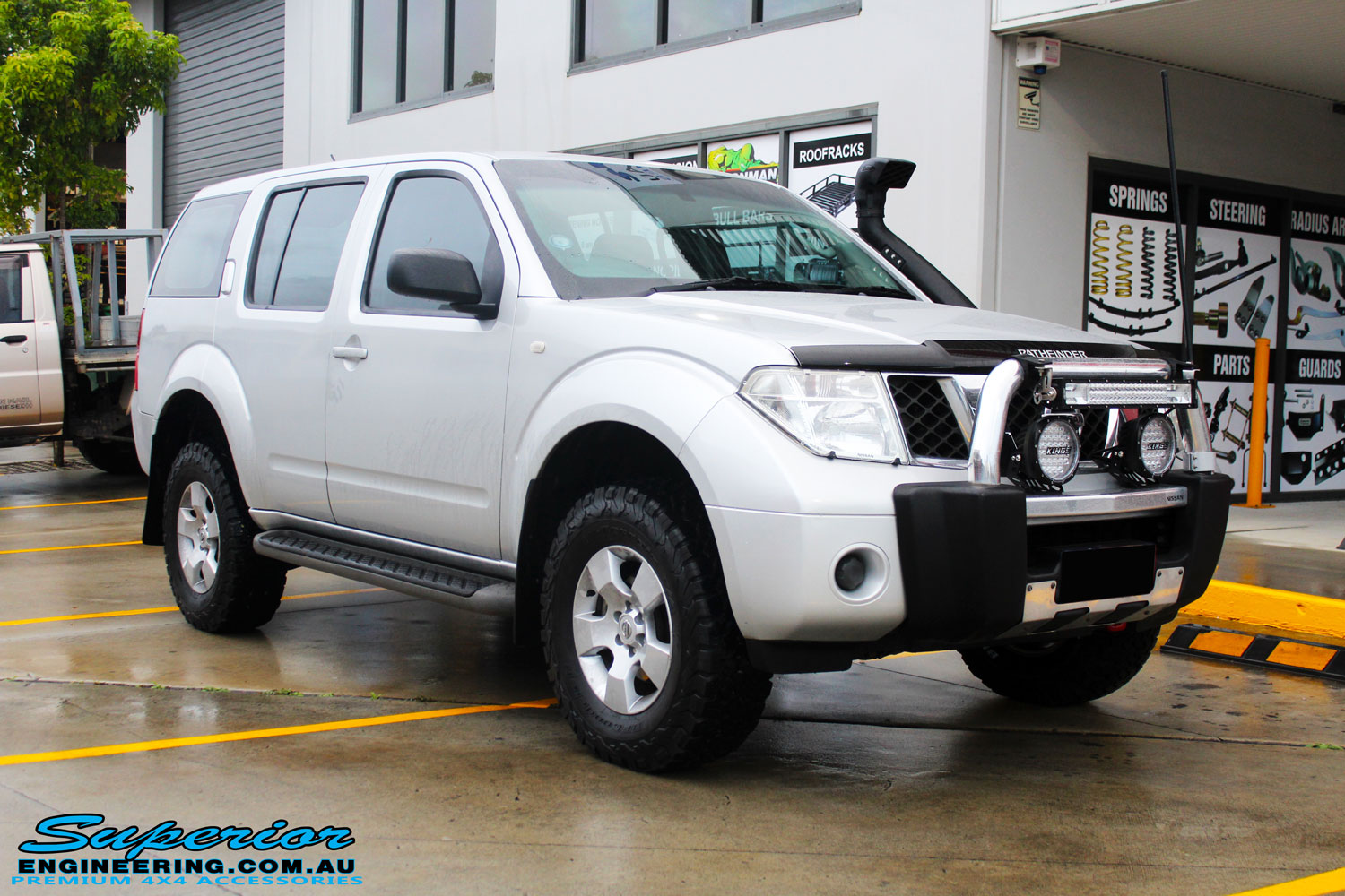 Right front side view of a Silver Nissan R51 Pathfinder Wagon before fitment of a 40mm Lift Kit & Safari Snorkel