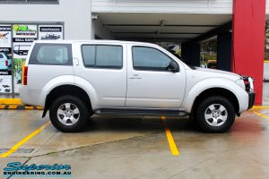 Right side view of a Silver Nissan R51 Pathfinder Wagon before fitment of a 40mm Lift Kit & Safari Snorkel